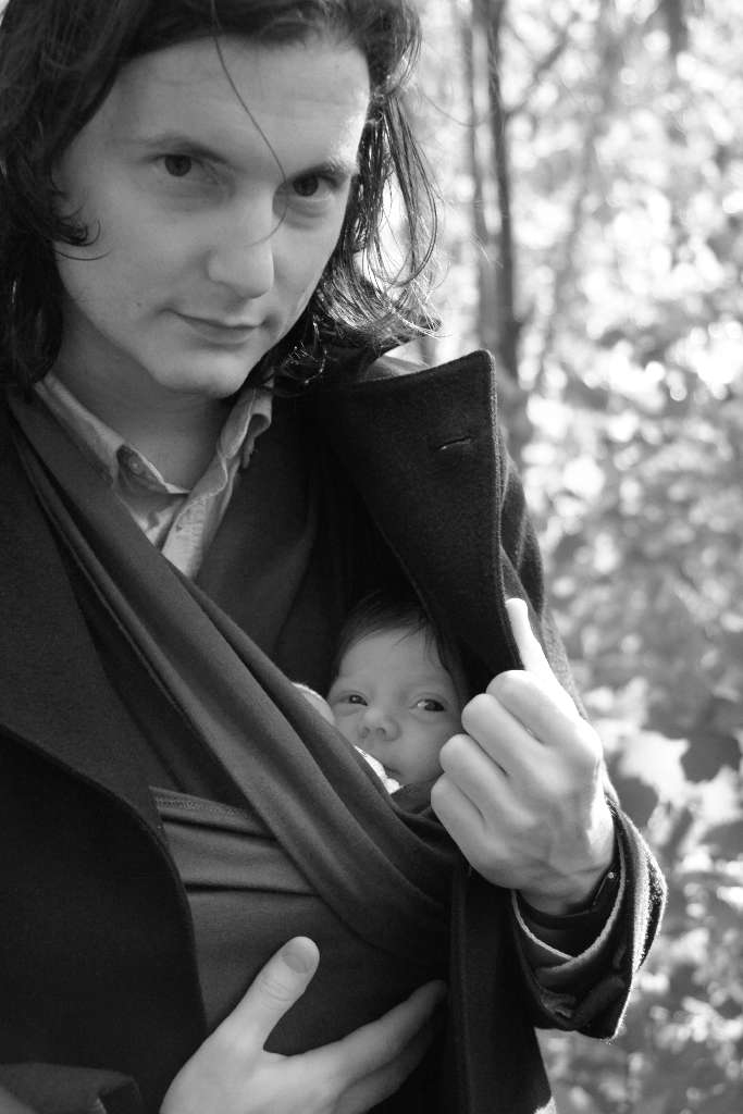 Cozy with a baby sling on a cold Swedish summer