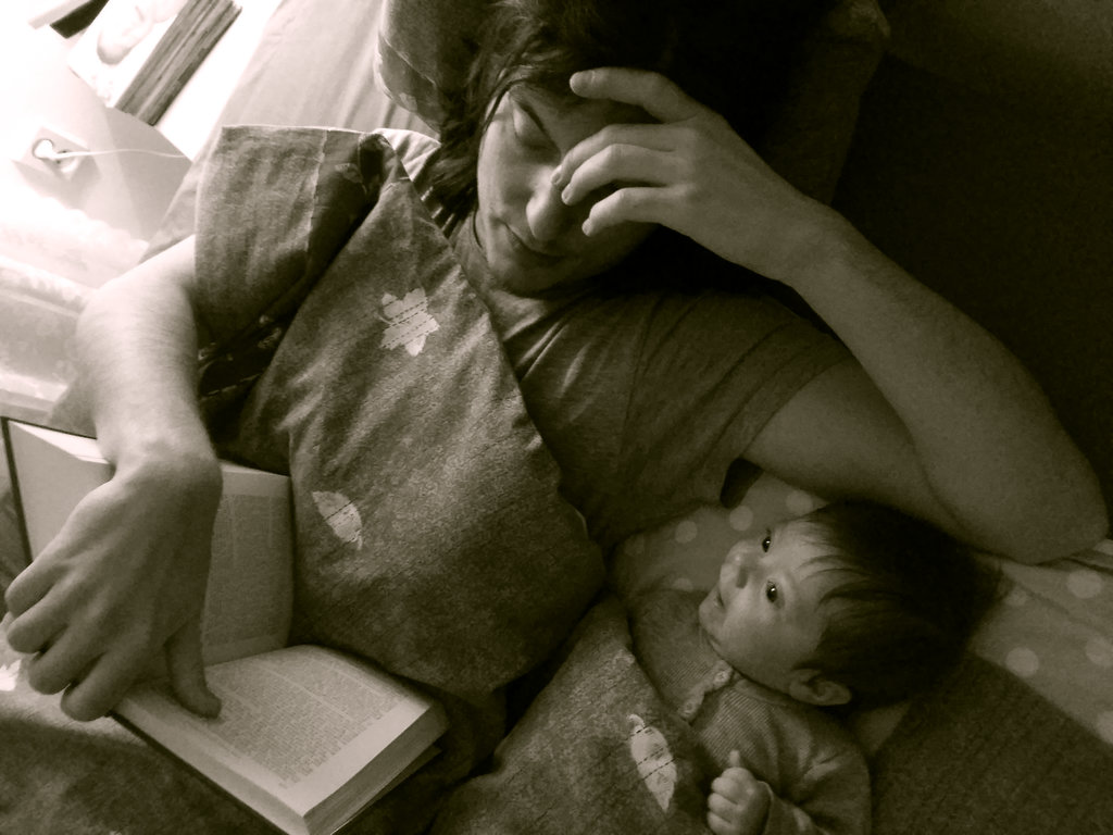 Sanjin reading to baby Florens. Photo: Lisa Sinclair.