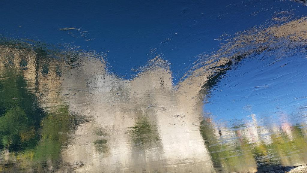 Stari Most Neretva reflection. Photo: Sanjin Đumišić.