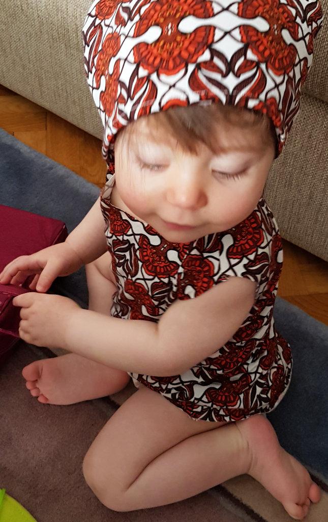 Baby Florens in mom's homemade dress. Photo: Sanjin Đumišić.
