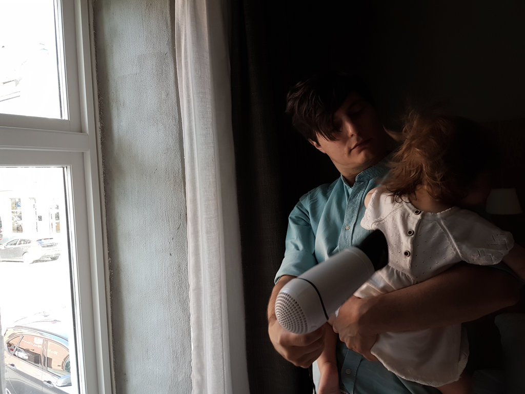 Sanjin hair drying baby Florens. Norway road trip. Photo: Sanjin Đumišić.