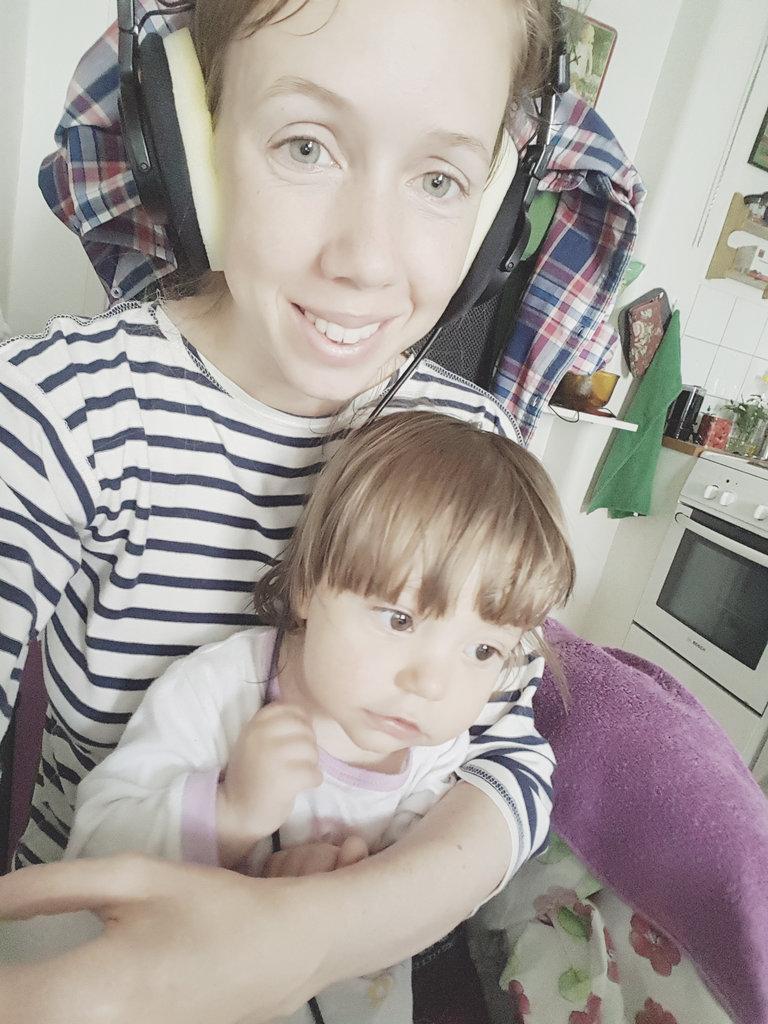 Lisa with baby Florens, kitchen music fun.