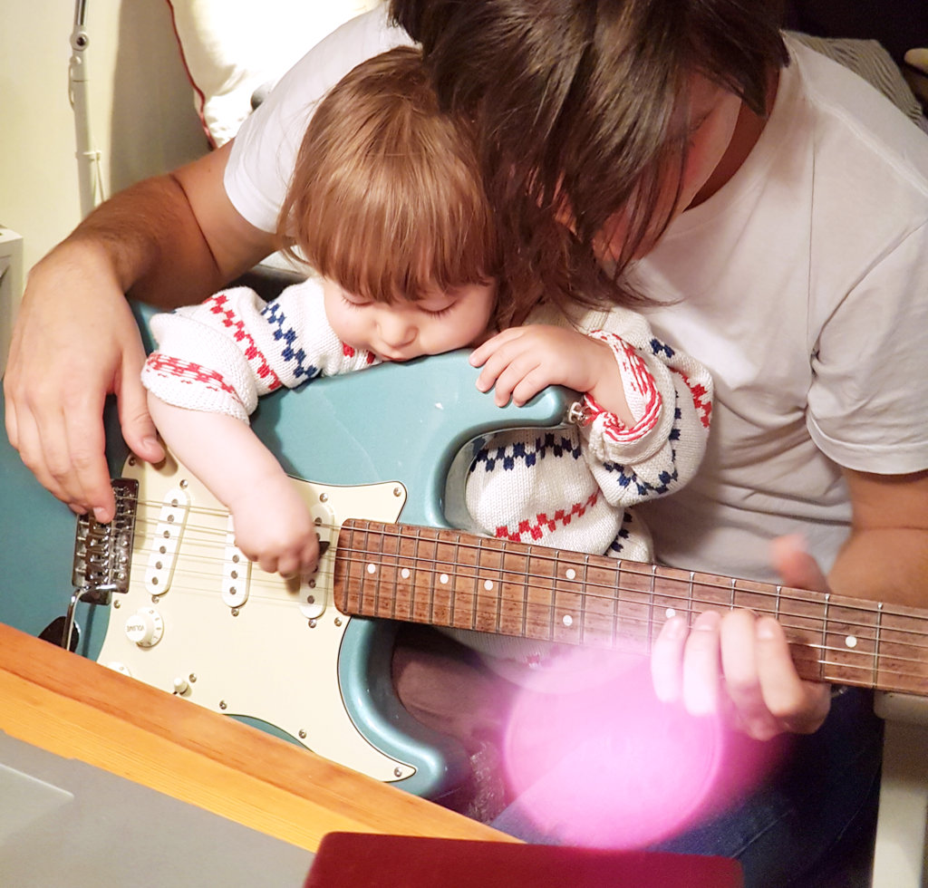 Baby Florens and Sanjin playing electric guitar. Photo: Lisa Sinclair.