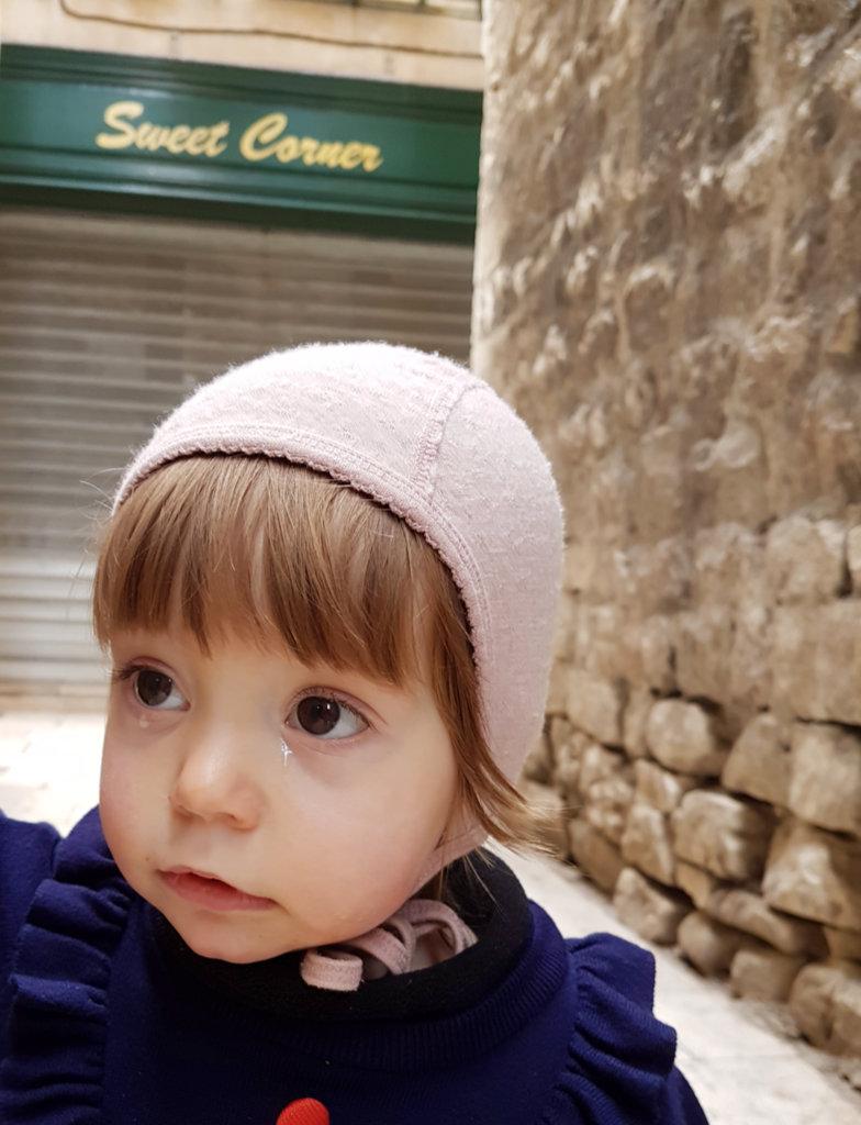 Baby Florens, twinkling cross in a tear. Photo: Sanjin Đumišić.