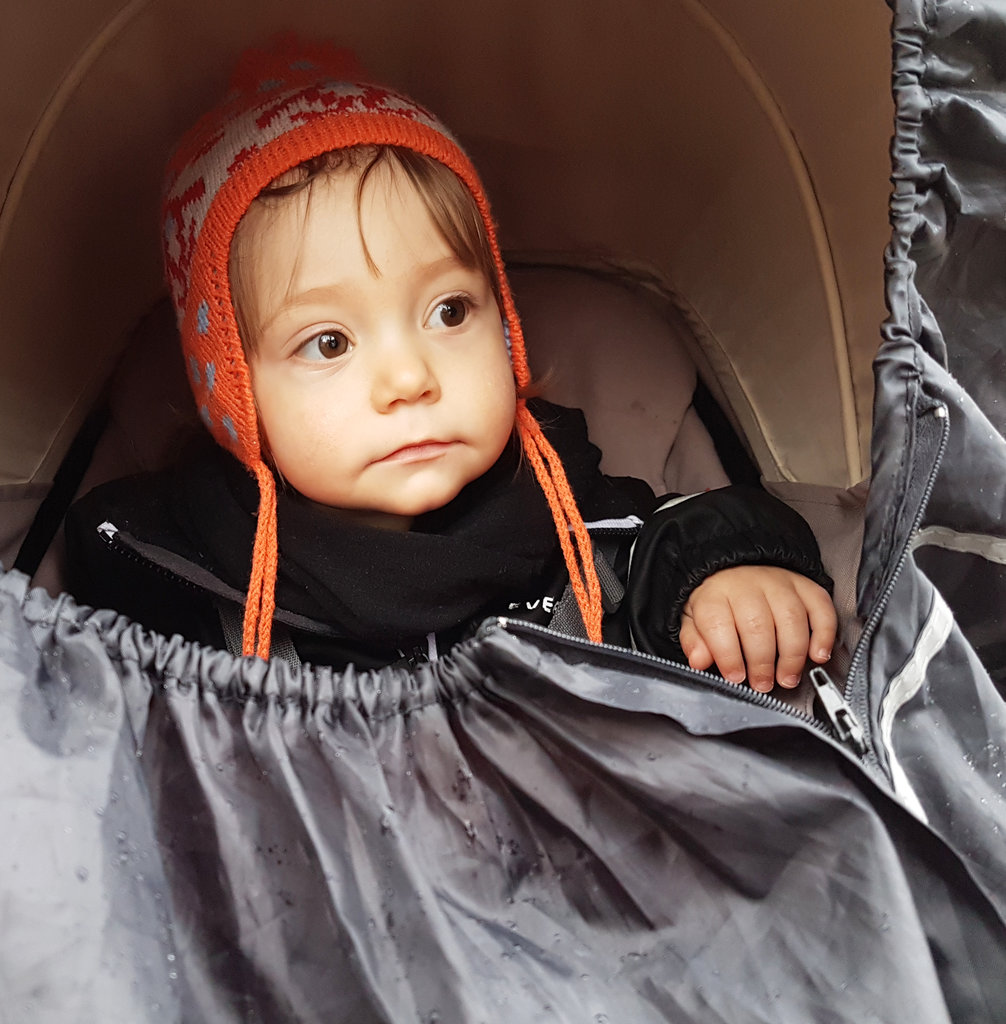 Baby Florens, in stroller on a rainy day. Photo: Sanjin Đumišić.