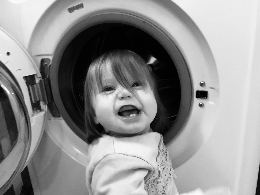Baby Aurelia, at the washing machine. Photo: Sanjin Đumišić.